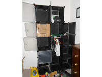 Stackable metal and plastic black storage boxes