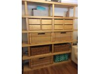 IKEA wooden shelving unit with baskets