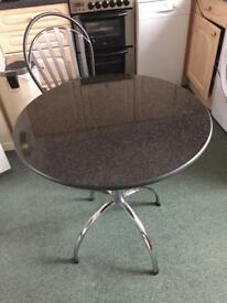 Round black marble topped table