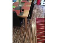 Zebrano preowned laminate flooring £50 changing style of kitchen cost around £500 new
