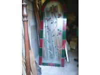Large ornate leaded window panel.