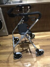 4 wheel walking aid with seat.