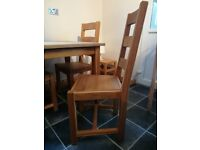 Solid oak kitchen table and four chairs for sale