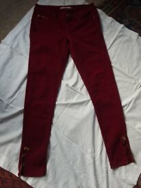 Deep Red Narrow Leg jeans.