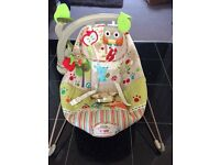 Baby bouncer with calming vibrations and detachable play tree