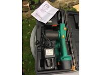 Battery powered chain saw lopper, with case and accessories and instructions
