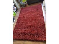 Dark red rug