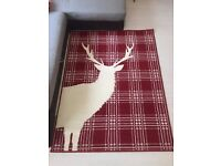 Used Red Floor Rug with White Reindeer / Chequer Pattern