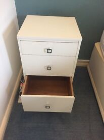 Pretty white small chest of drawers and two matching bedside tables