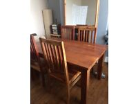 Lovely wooden table and six chairs