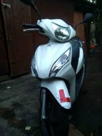 Honda vision 110 , 2012, white excellent condition low mileage .
