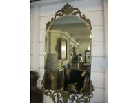 VINTAGE ORNATE GILT EDGED OVAL TOPPED BEVELLED MIRROR. IN GOOD ORDER. VIEWING/DELIVERY AVAILABLE