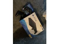 PlayStation 4 500GB Black console with 2 controllers and 4 games