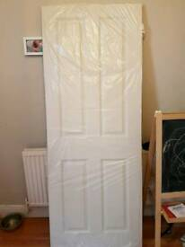 Brand new Four panel mid weight moulded door with hinges,latch and handle