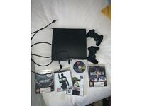 Ps3 with 2 controllers + games