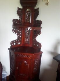 Corner unit....mahogany colour....lots of intricate detail...beautiful piece for any home...........