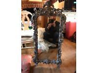 Black/grey ornate wooden mirror