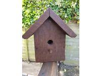 Hand made wooden bird house nesting box