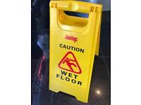 Caution sign (wet floor)