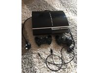 playstation 3 with games and 2 controllers