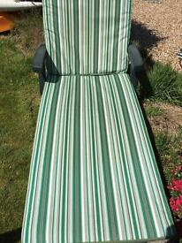 2 sun loungers with cushions