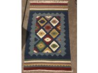 Handmade knotted rug
