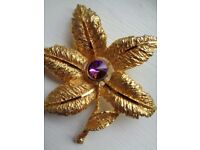 Beautiful Yellow Metal Flower Brooch With Purple Stone