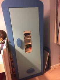 Blue Ikea mammut child wardrobe with added mirror