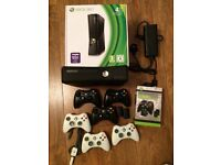 Xbox 360 slim 4GB (+ 16GB HD) + multiple controllers, dual charger, 17 games, wireless headset etc.