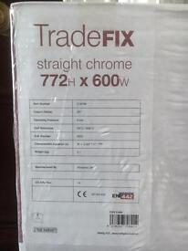 Chrome Heated towel rail.