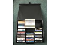 Variety of music and story casettes in carry case