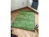 two large green furry carpets