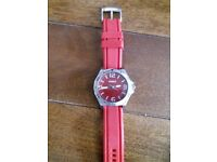 Fossil red face and strap watch