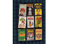 A collection of 9 vintage MAD paperback comic books