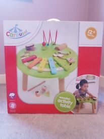 Carousel wooden activity table