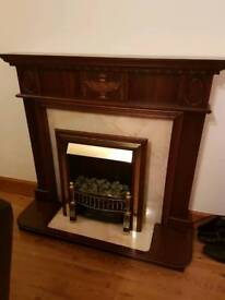 Dark Mahogany fireplace with electric fire