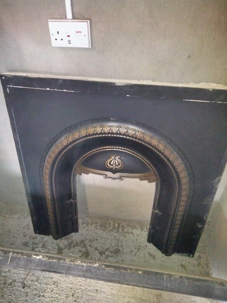 Cast iron fireplace, wooden surround, hearth and inset
