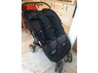 Double buggy: Baby jogger city mini. Includes 2 red footmuffs and rain cover. Excellent condition