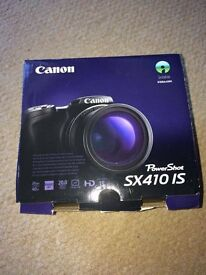 Canon PowerShot SX410 with accessories and box