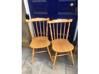 2 x modern pine chairs , good sturdy chairs .