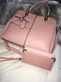 Pink leather bag with matching purse