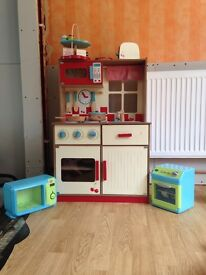 Wooden kitchen and all accessories shown