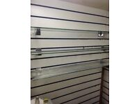 Slat wall glass shelves with brackets shop fittings