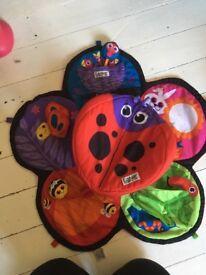 Lamaze tummy time spinning mat