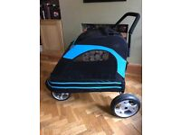 Large dog pushchair, for large dogs up to 100lbs. Folds flat. Fixed or swivel wheels, rear brakes.