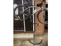 Bicycle storage stand for 2 bikes, just lift them off when required. Stands against a wall.