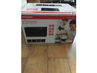 SHARP R-374KM microwave oven.