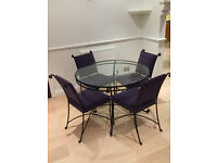 For Sale - Wrought iron Marks & Spencers round Dining Table with four matching chairs