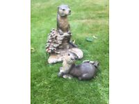 Two stone otters suitable for garden or pond area