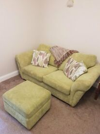 DFS 2 seater fabric sofa bed and storage footstool. Only 15 months old. Selling due to re-location.